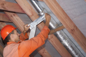 a man wraps a duct | duct sealing isle of palms